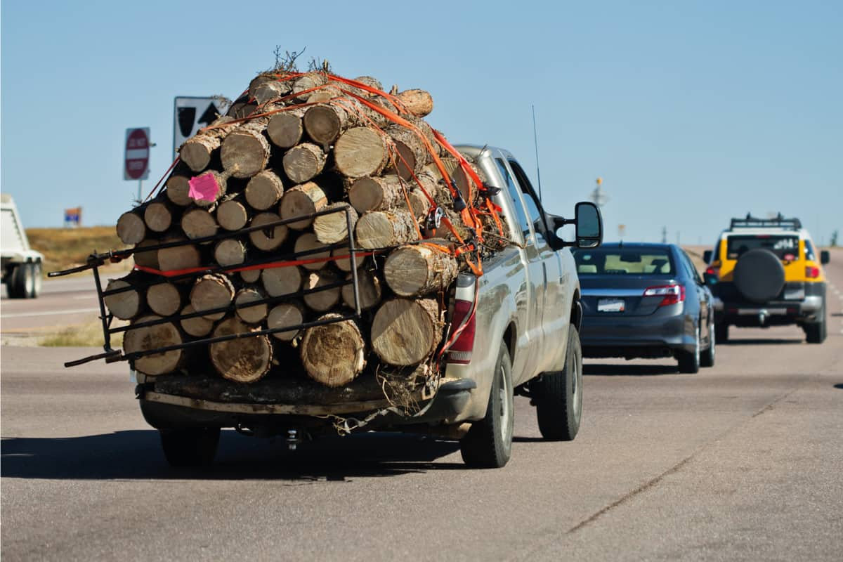 Pickup truck overloaded with cargo on a highway