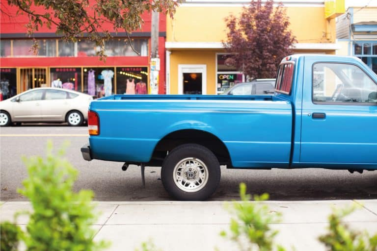 A blue pickup truck parked along a quiet neighborhood, Truck Bed Dimensions - Length and width by bed type