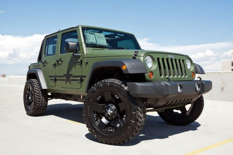 A green Jeep Wrangler parked on a sunny parking lot, When Is The Best Time To Buy A Jeep Wrangler?