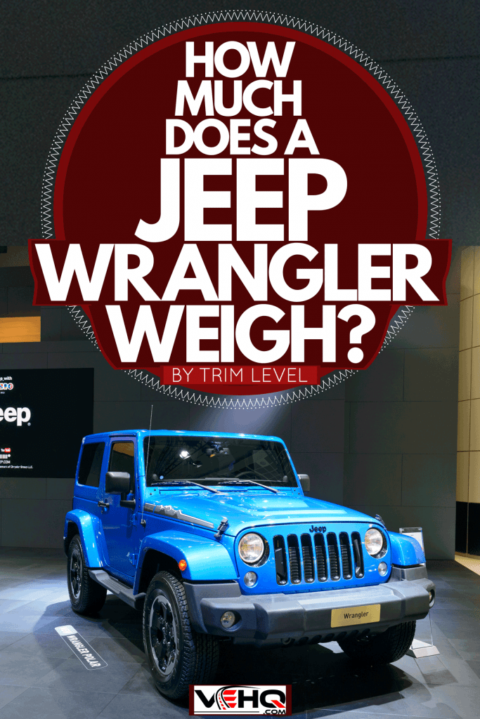 A new blue tough looking Jeep Wrangler on a car show, How Much Does A Jeep Wrangler Weigh? [By Trim Level]