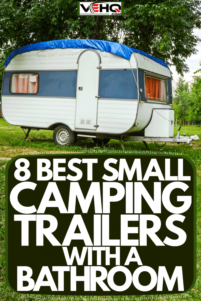 A small camping trailer parked outside a camping ground, 8 Best Small Camping Trailers With A Bathroom