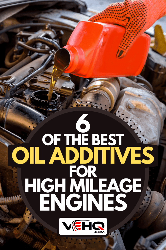 A hand in protective glove with oil bottle, 6 Of The Best Oil Additives For High Mileage Engines