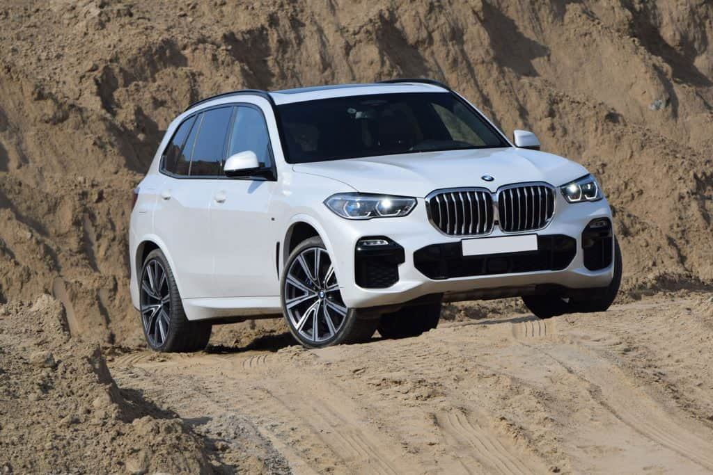 A BMW X5 trekking a dirt road, Is 2WD The Same As Front Wheel Drive (FWD)?