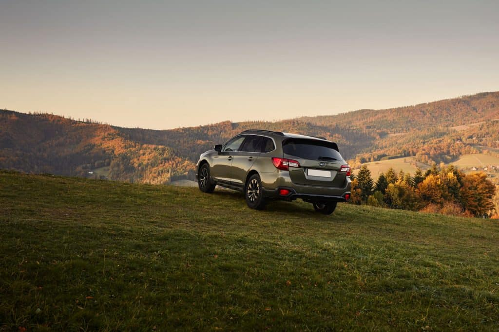 A Subaru Outback trekking the scenic view of the countryside