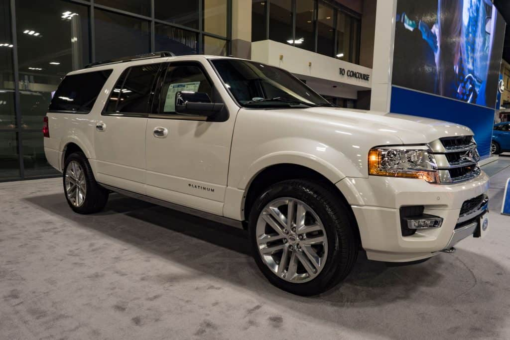A luxurious Ford Expedition parked outside a car dealership, Ford Expedition Gas Mileage And Engine Specs