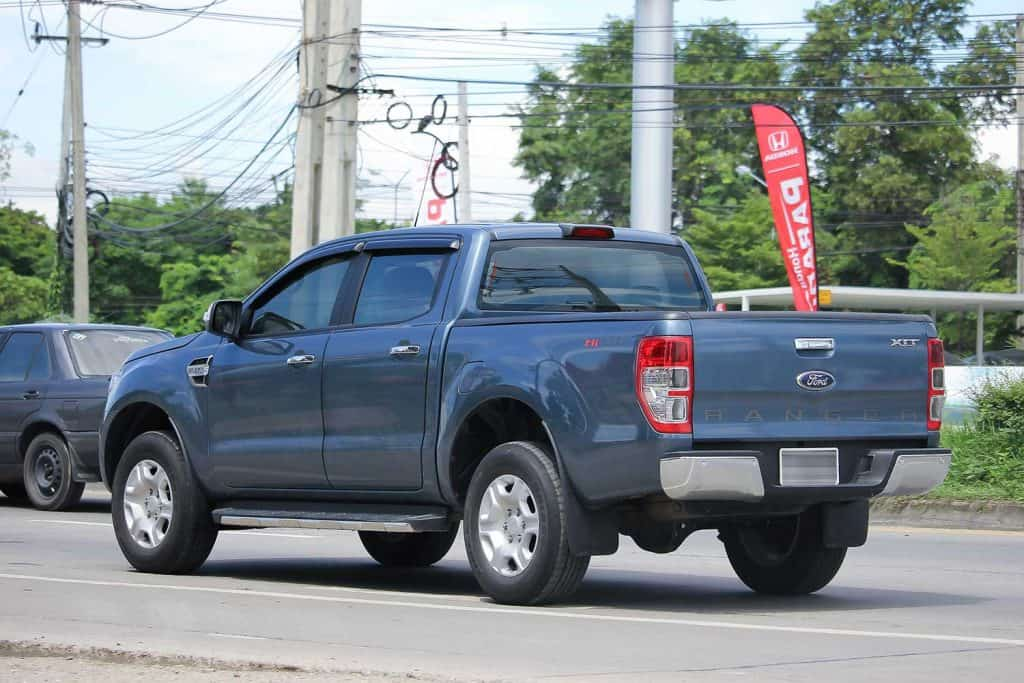A private pickup Ford Ranger running on the street