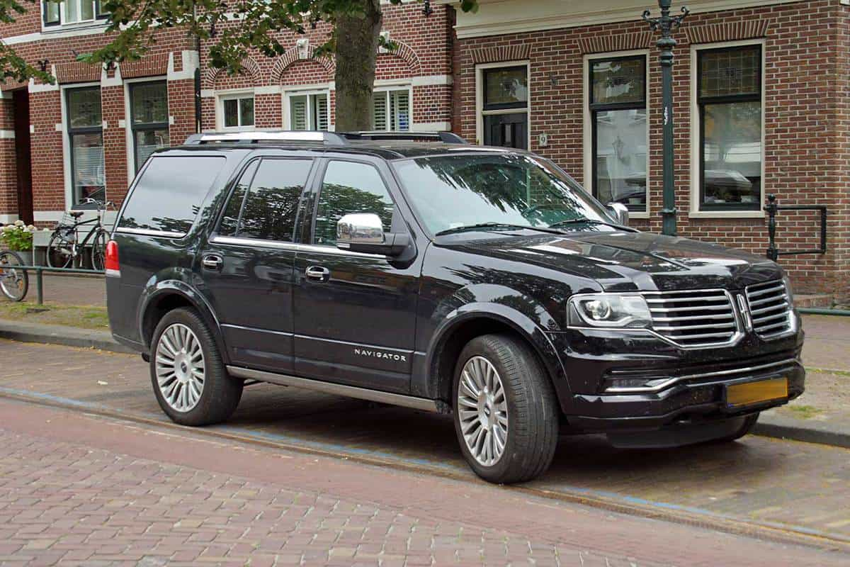 Black Lincoln Navigator parked by the side of the road