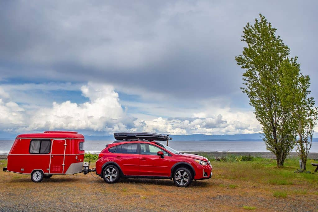 Car camping with antique tiny trailer