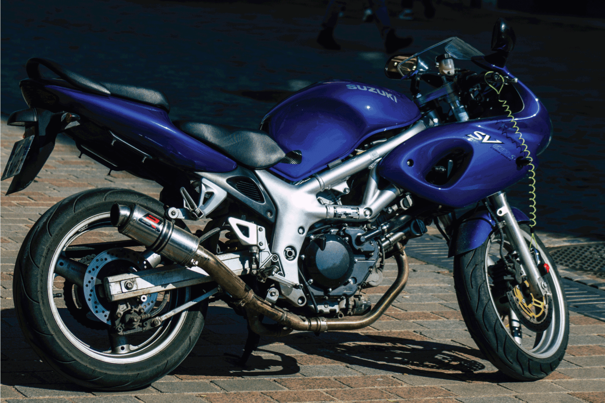 Closeup of a SUZUKI SV 650 S motorcycle parked in the historical streets of Reims
