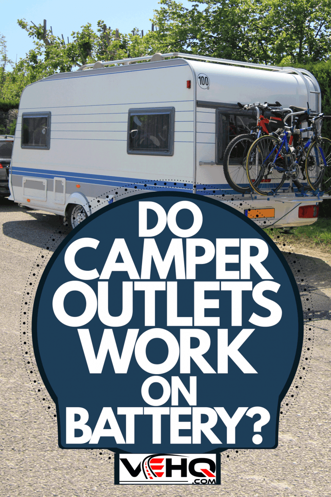 An SUV towing a camper trailer with mountain bikes clamped on the back of the camper, Do Camper Outlets Work On Battery?