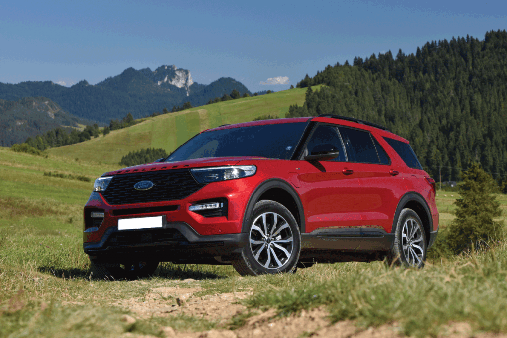 Ford Explorer V6 Plug-in Hybrid stopped on a road in mountain scenery. Ford Explorer Cargo Space Specs