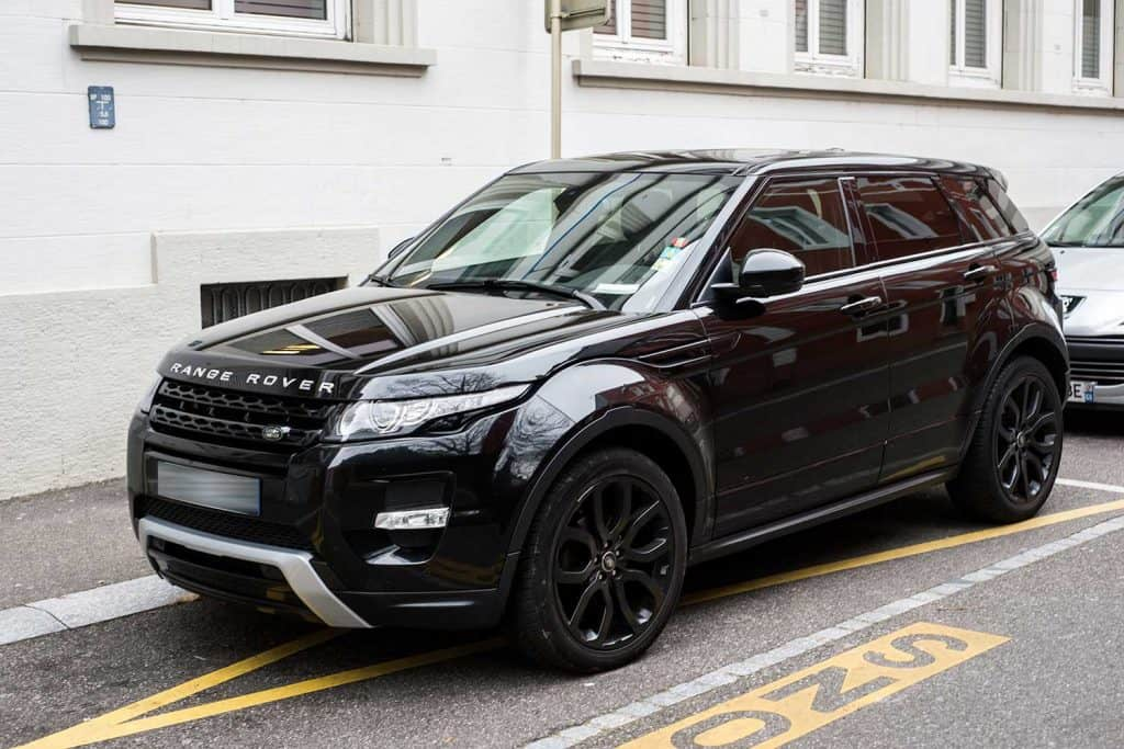 Front view of black range rover parked in the street