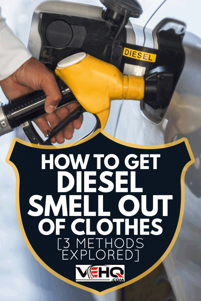 Man hand holding yellow petrol pump, How To Get Diesel Smell Out Of Clothes [3 Methods Explored]