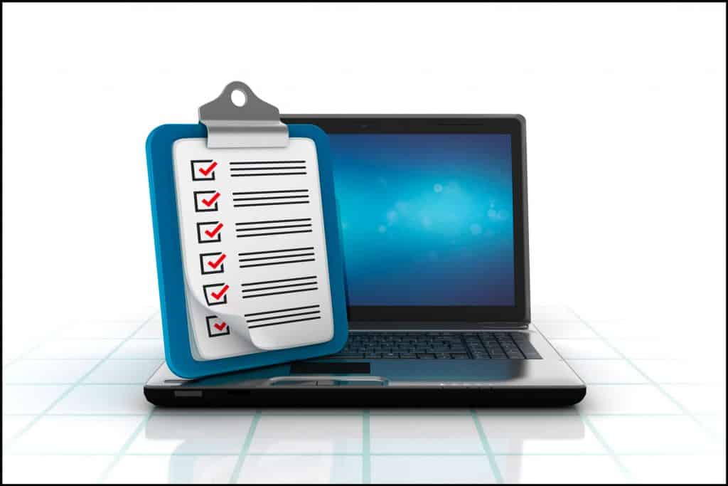 Laptop with Clipboard Check List