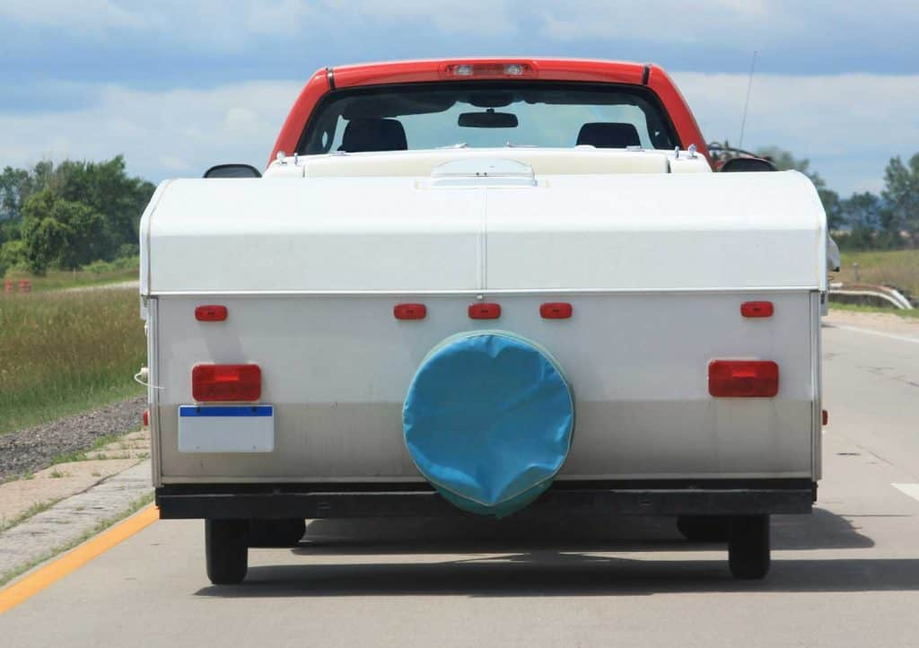 Pickup truck with camping tent and gears