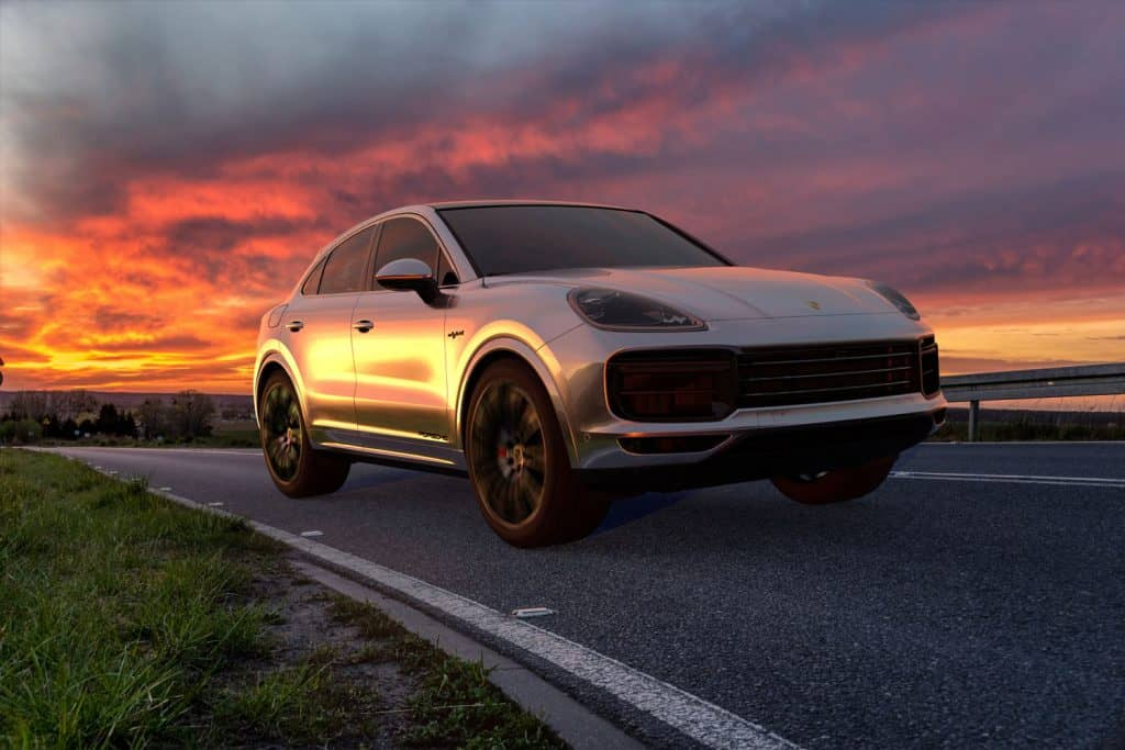 Porsche Cayenne driving along the road on sunset, What SUVs Can Tow At Least 5000 Lbs?
