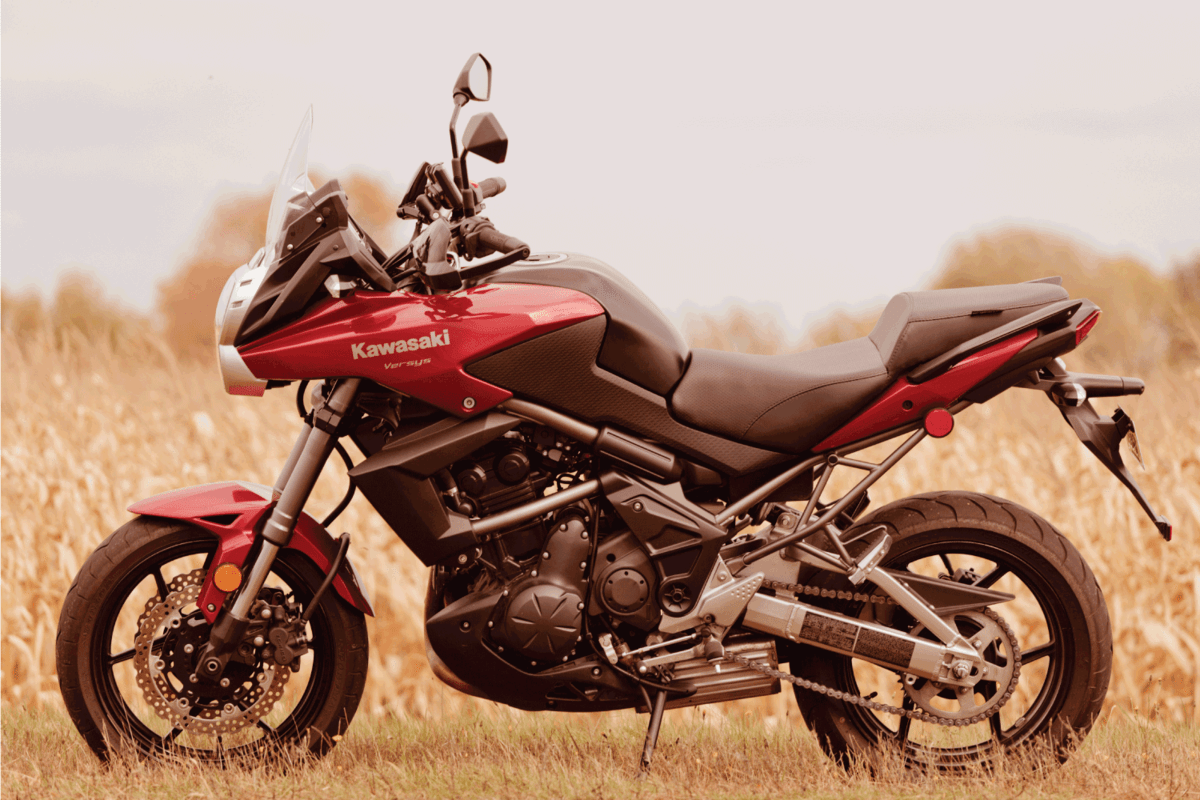 Red Kawasaki Versys on the side of the road.
