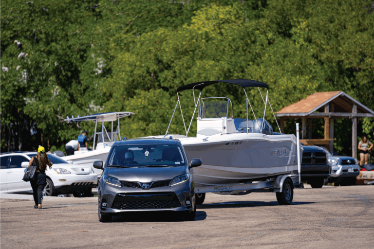 Toyota Sienna towing a boat. How Much Does A Toyota Sienna Weigh