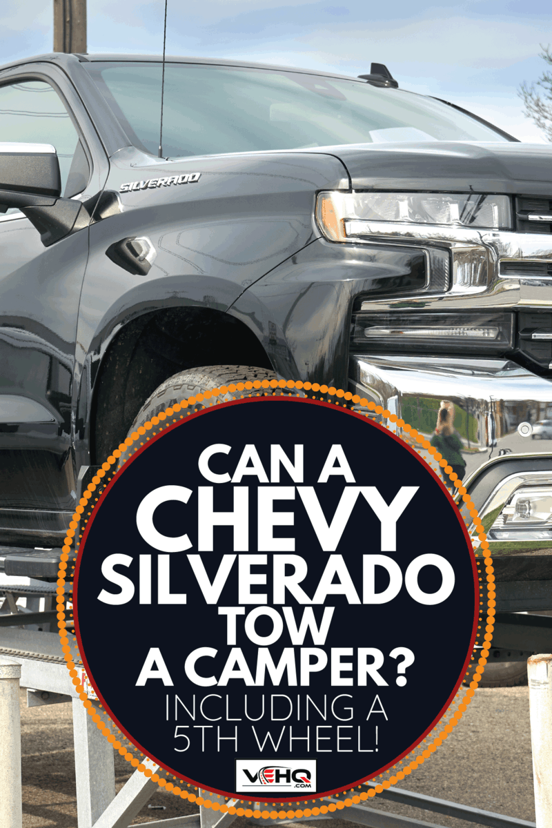 chevy silverado on a raised platform for display. Can A Chevy Silverado Tow A Camper [Inc. A 5th Wheel!]
