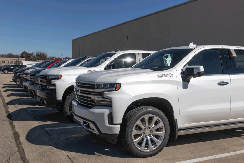chevy-silverados-on-display-in-a-dealership-carpark.-Can-A-Chevy-Silverado-Tow-A-Camper-[Inc.-A-5th-Wheel!], Can A Chevy Silverado Tow A Camper? [Inc. A 5th Wheel!]
