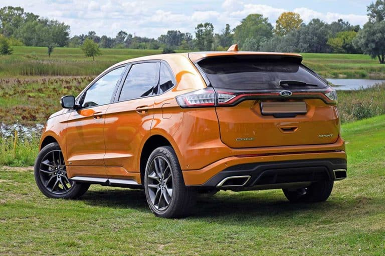 2016 Ford Edge stopped on the grass, How Big Is The Ford Edge Cargo Area? [Dimensions For 2021 Models]