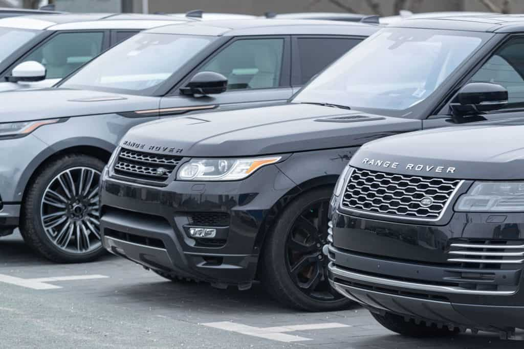 A black colored Range Rover Velar parked on a car dealership, What SUVs Have Cooled Seats?