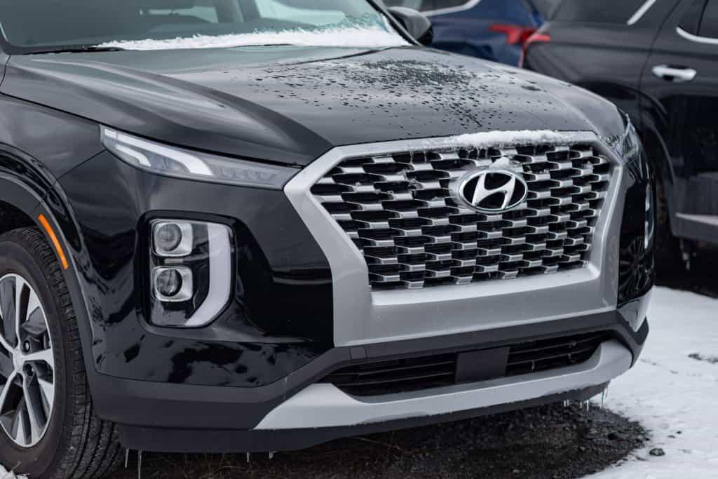 A Hyundai Palisade photographed on the parking lot, Is The Hyundai Palisade Bigger Than The Kia Telluride?