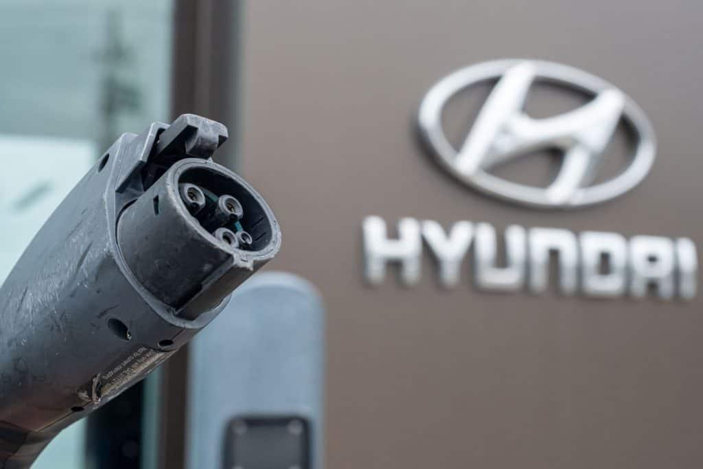 A Hyundai charging station outside a Hyundai dealership