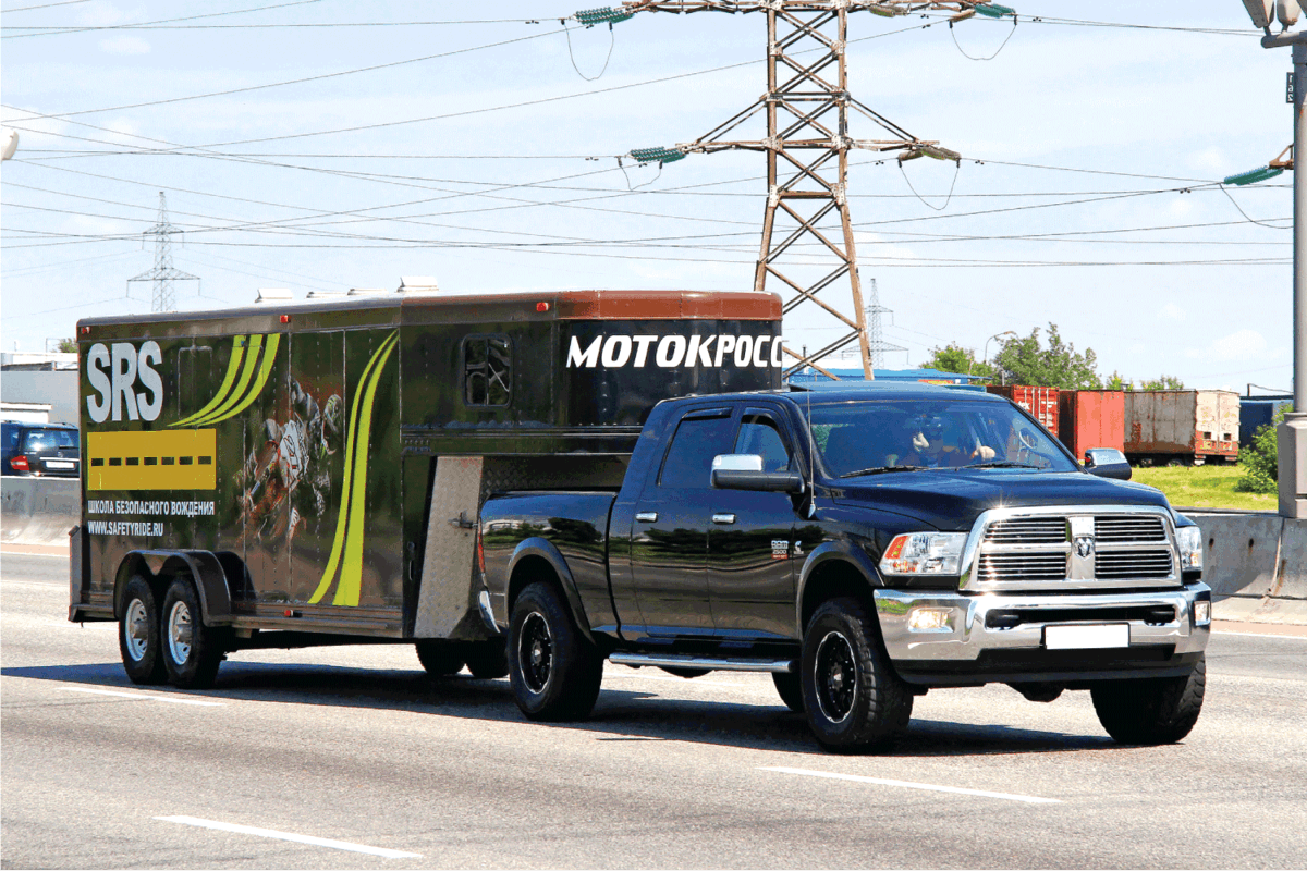 American pickup truck Dodge Ram 2500 of the motocross racing team drives at the interurban road.