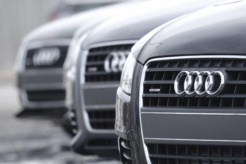 Audi A4 Quattro sedans on display at an Audi dealership