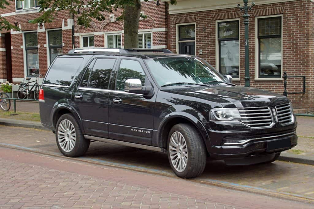 Black Lincoln Navigator parked by the side of the road. Nobody in the vehicle