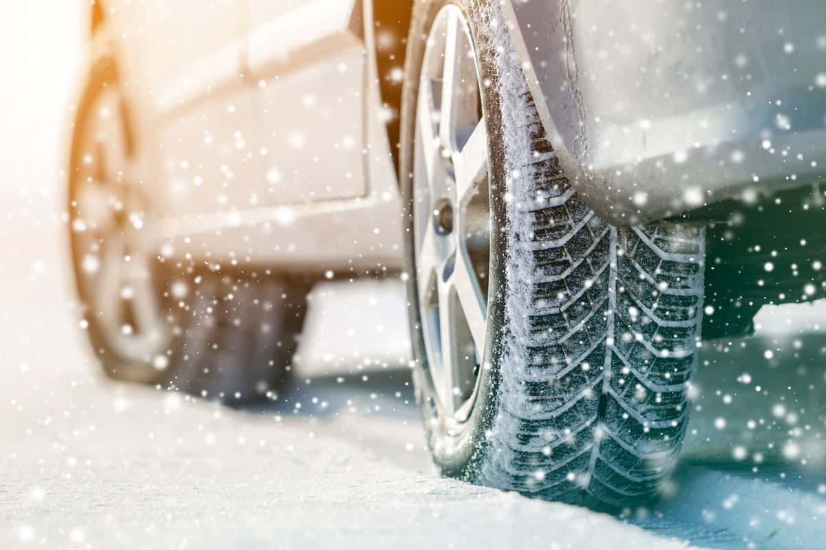 Close-up of car wheels rubber tires in deep winter snow