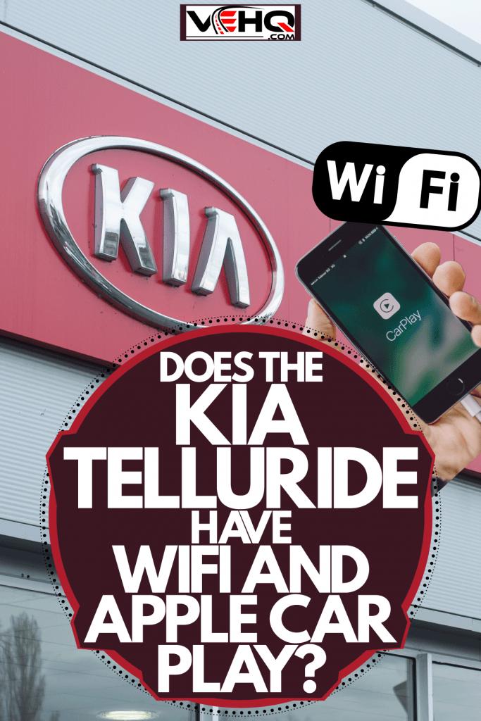 A Kia company logo photographed outside a dealership, Does The Kia Telluride Have Wifi And Apple Carplay?