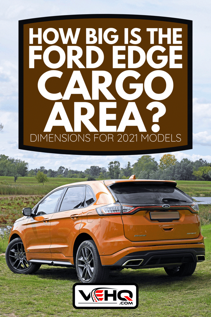 A 2016 Ford Edge stopped on the grass, How Big Is The Ford Edge Cargo Area? [Dimensions For 2021 Models]