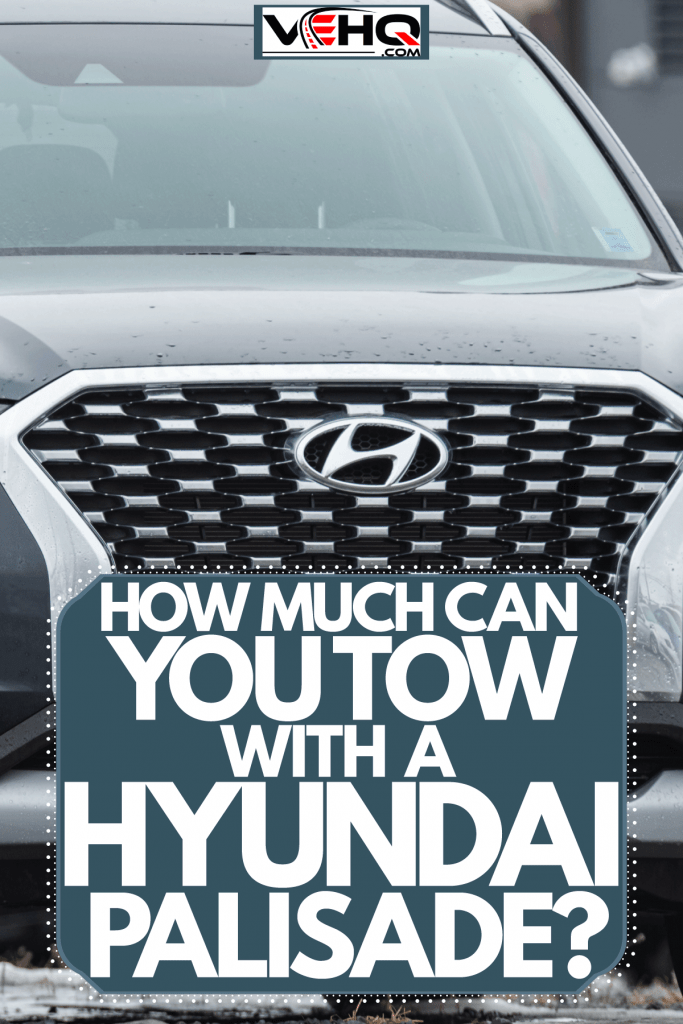 A photo of a Hyundai Palisade grill with a pure stainless steel Hyundai emblem on it, How Much Can You Tow With A Hyundai Palisade?