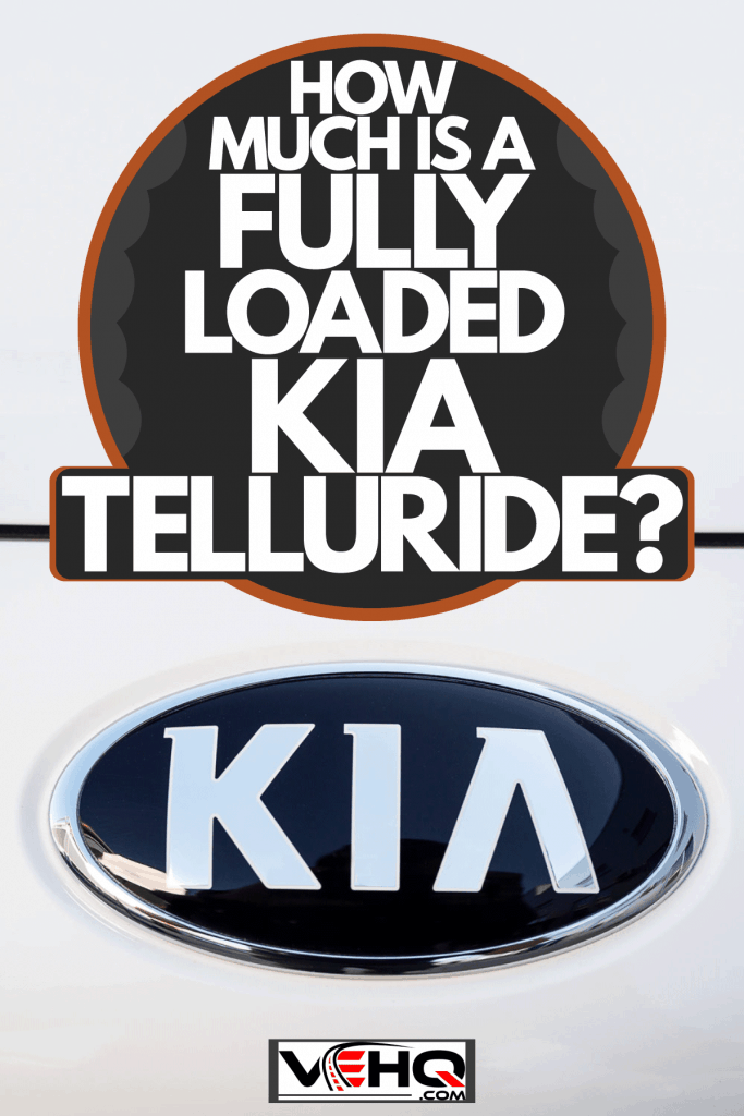 An up close image of a Kia Logo on the back of an SUV, How Much Is A Fully Loaded Kia Telluride?