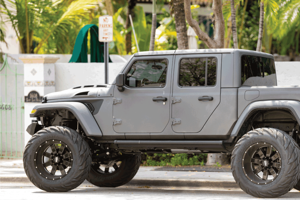 Jeep Gladiator 4x4 vehicle lifted with oversized wheels and off road tires