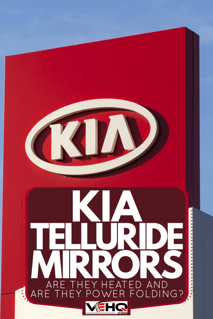 A huge Kia logo sign on a red tall post, Kia Telluride Mirrors: Are They Heated And Are They Power Folding?