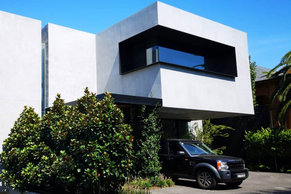 Modern, luxury, detached house with a back car parked into the garage, Should You Back Your Car Into The Garage?