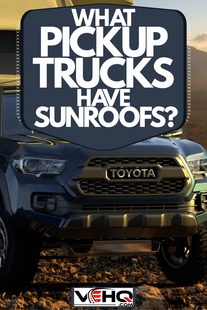 A Toyota Tacoma parked outside a camping park with a tent set up right on top of the truck bed, What Pickup Trucks Have Sunroofs?