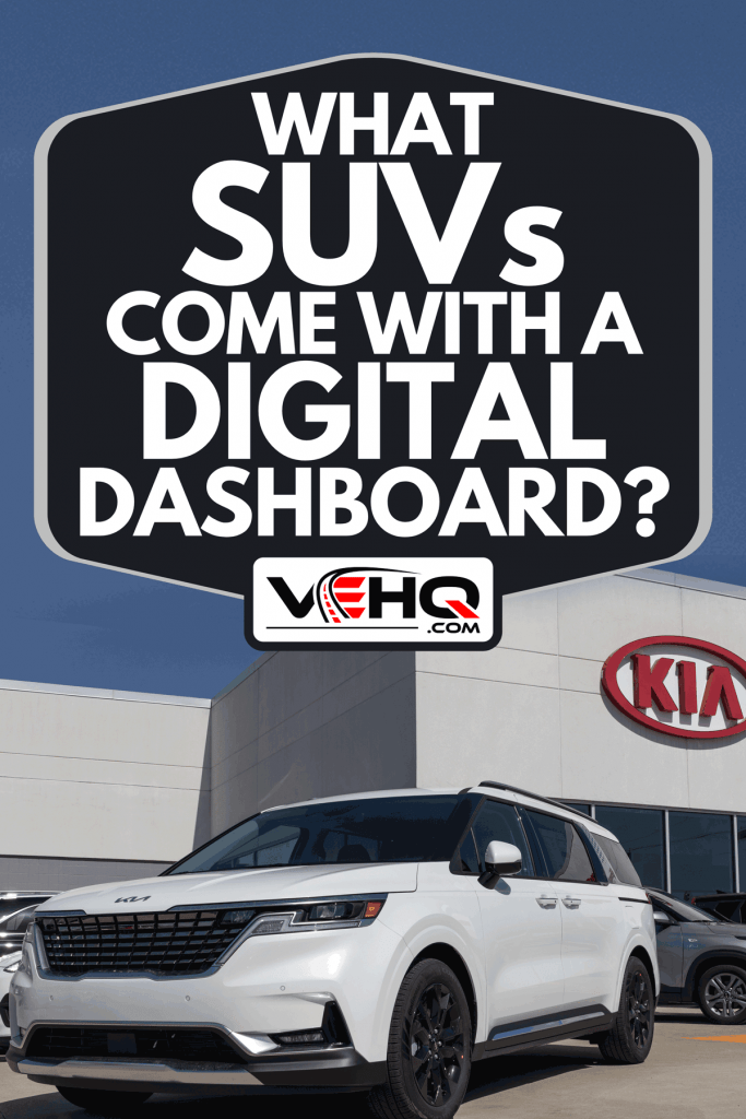 Kia Carnival parked at Kia Motors car dealership, What SUVs Come With A Digital Dashboard?