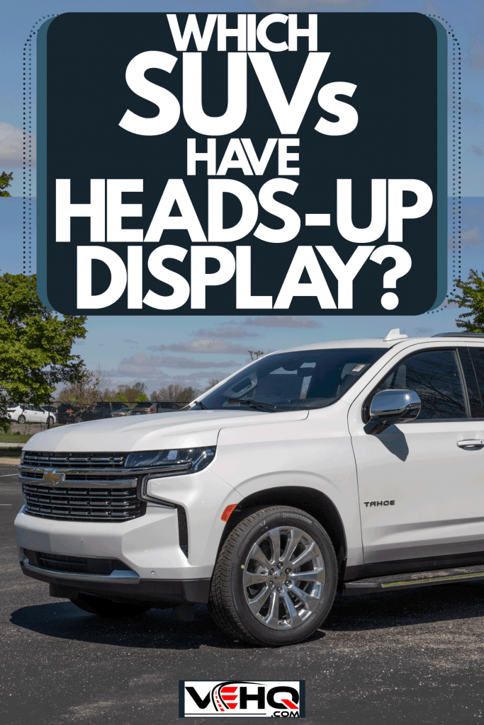 A huge white colored Chevrolet tahoe parked outside a parking lot, Which SUVs Have Heads-Up Display?