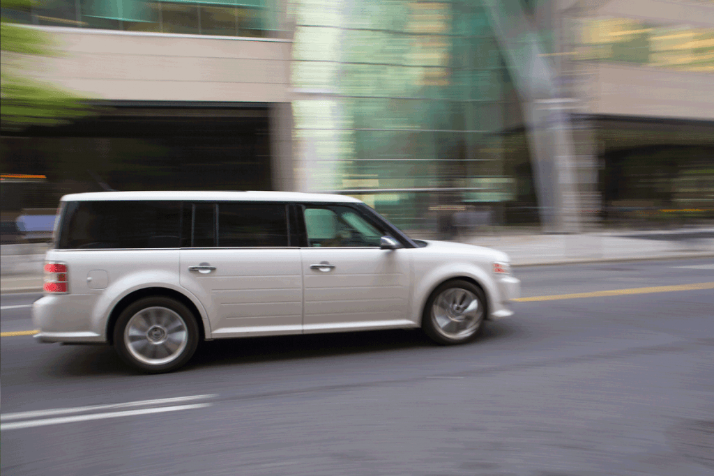 White Ford Flex CUV (Cross Over Utility Vehicle), speeding in Toronto. What Are The Ford Flex Cargo Dimensions