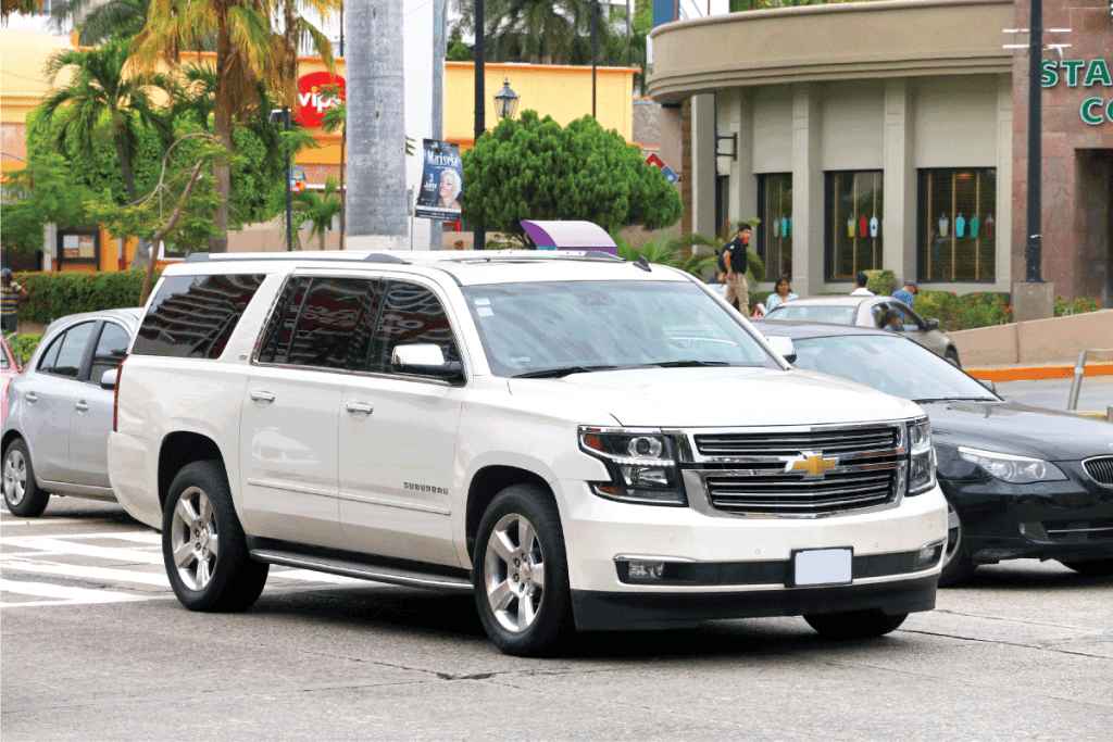 White-motor-car-Chevrolet-Suburban-in-the-city-street-looking-for-parking,-Which-SUVs-Have-Front-Parking-Sensors