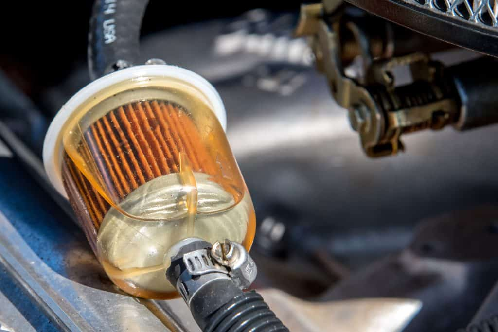A fuel filter in a car. Gasoline can be seen in the filter