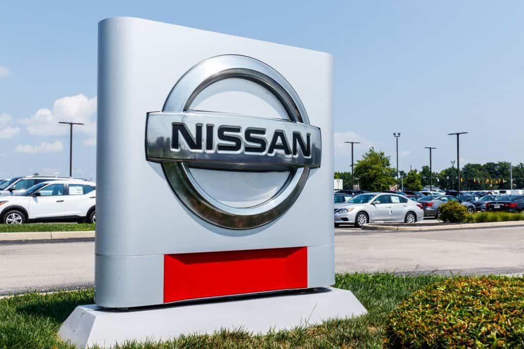 A huge Nissan Logo sign outside a dealership