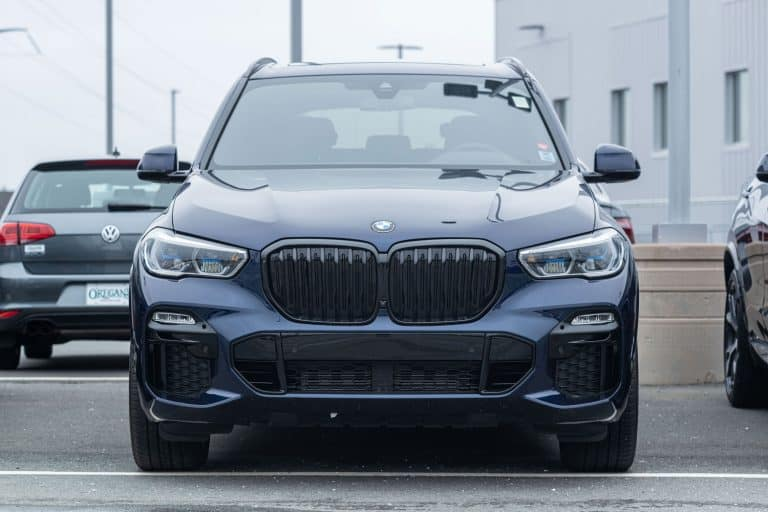 A luxurious BMW X5 parked outside a dealership, Which SUVs Have Night Vision?