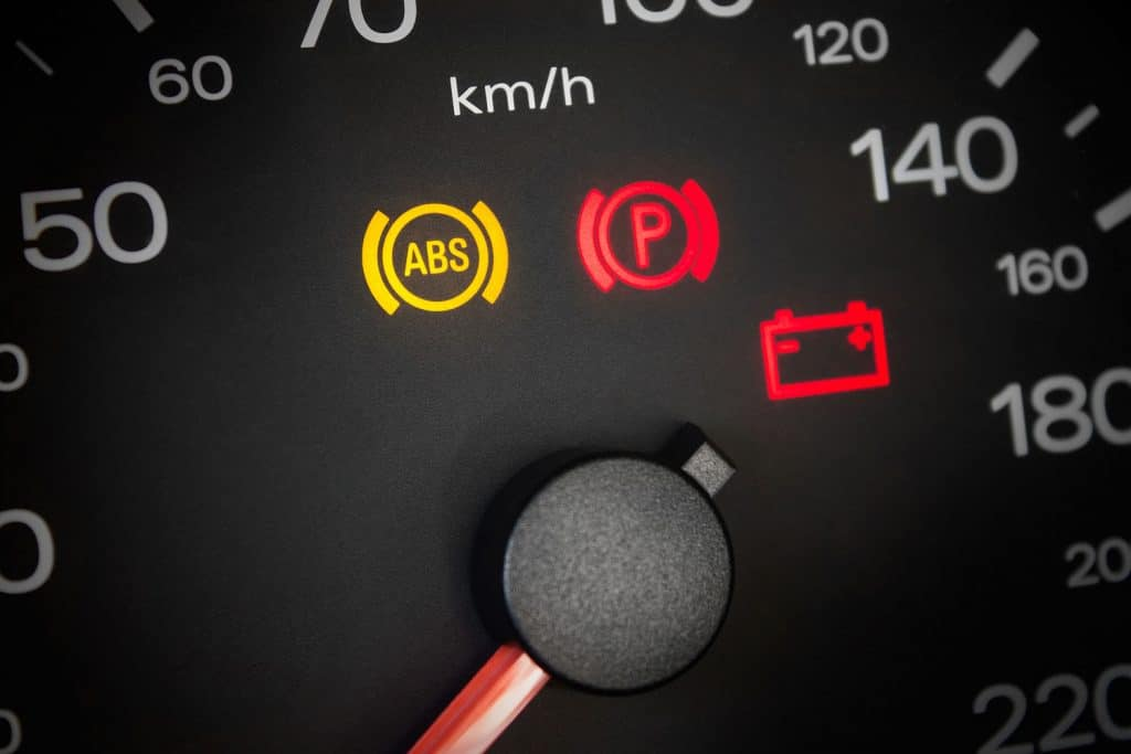 ABS light. Car dashboard in closeup, ABS Light Comes On When Braking - What to Do?
