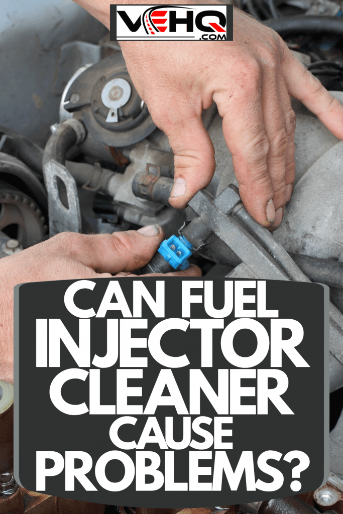 A car mechanic removing the fuel injector of a car, Can Fuel Injector Cleaner Cause Problems?