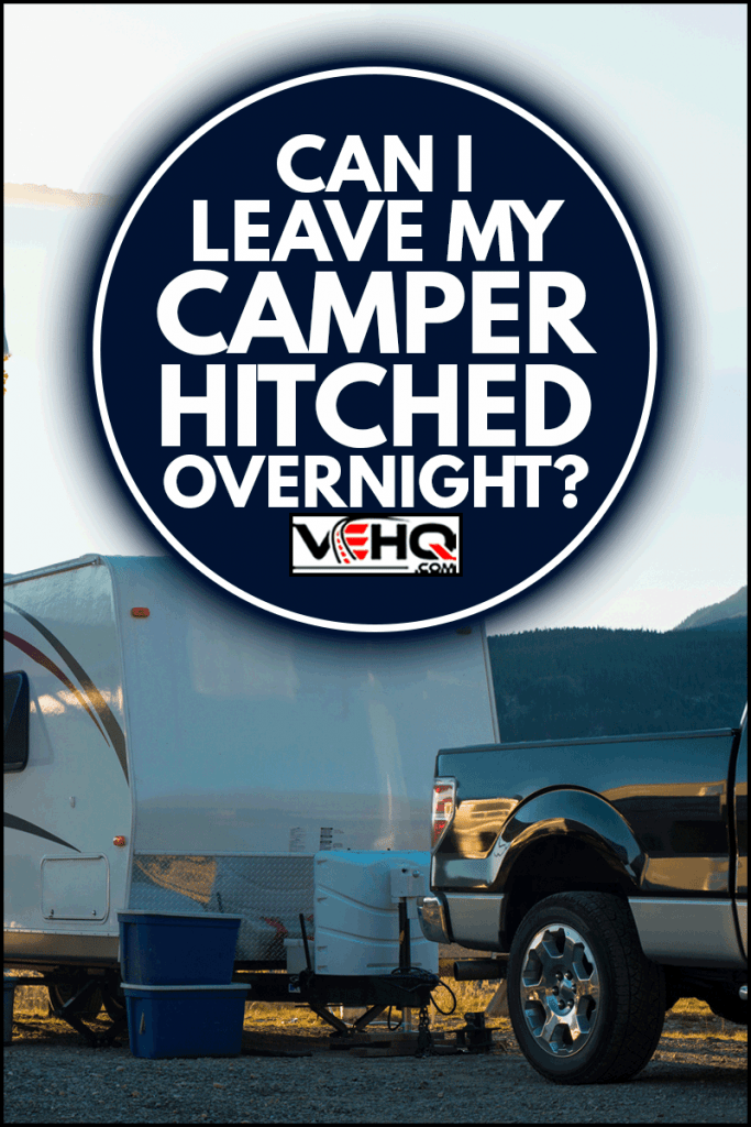 White recreational vehicle parked up at sunset, Can I Leave My Camper Hitched Overnight?